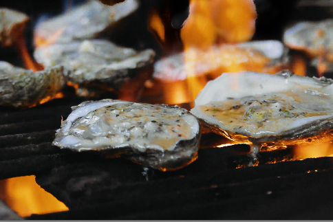 Smoke and flames add flavor to these oysters on the grill.