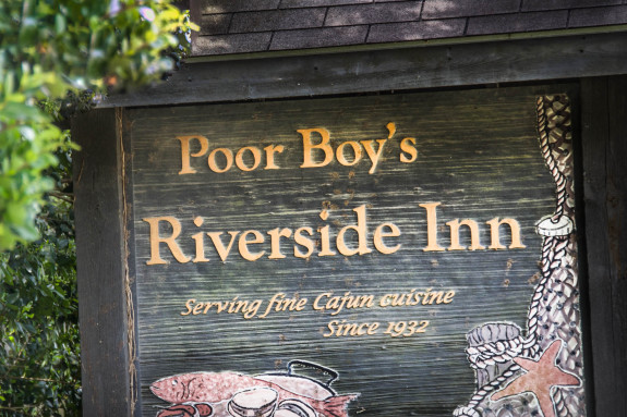 Poor Boy's Riverside Inn sign