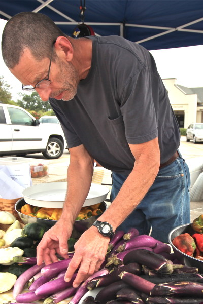 Charles Thompson at his farmers' market stall brings Cajun recipe ingredients to market.