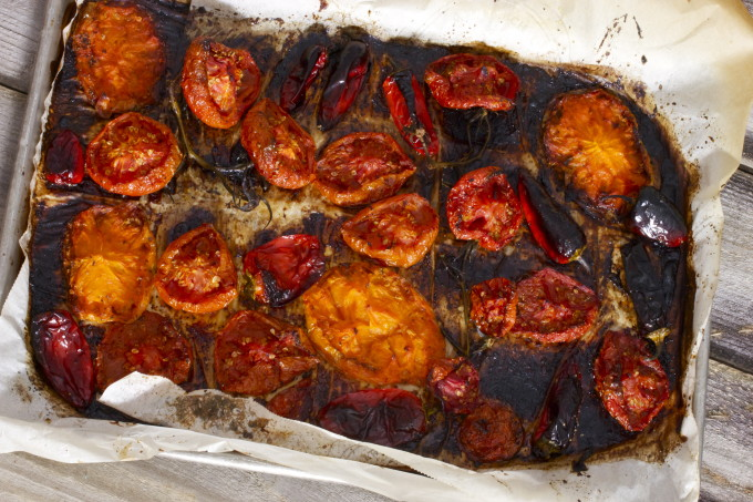 Roasted tomatoes for a Blackened Bloody Mary -- a classic cocktail with Cajun recipe flavors.