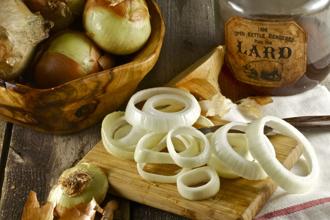 Cut your onions in varying sizes at a medium thickness, and fry in lard for a Cajun onion rings recipe twist.