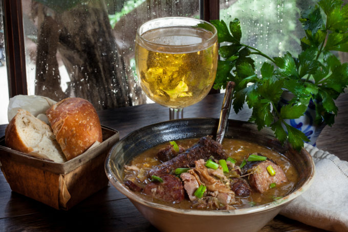 Succulent morsels of pork clinging tenderly to the bone swim in a bowl of dark roux-based gravy in this Cajun recipe for Pork Neck Bone Fricassée. (All photos credit: George Graham)