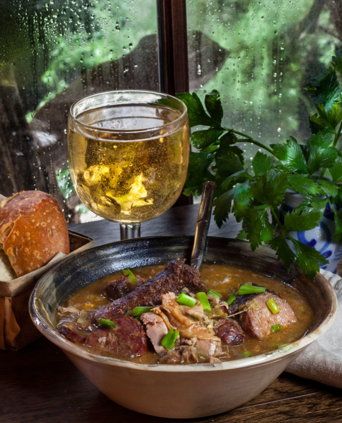 Ice-cold beer and hot french bread are the perfect accompaniment to this Pork Neck Bone Fricassée recipe.