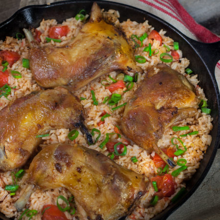 Crisp chicken thighs top rich tomato-infused Louisiana jasmine rice in this classic Creole dish. (All photos credit: George Graham)