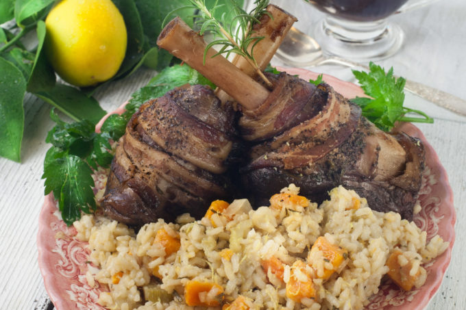 Not a typical Cajun recipe, Bacon-wrapped lamb shanks on the bone smoked in pecan wood pairs perfectly with sweet potato risotto. (All photos credit: George Graham)
