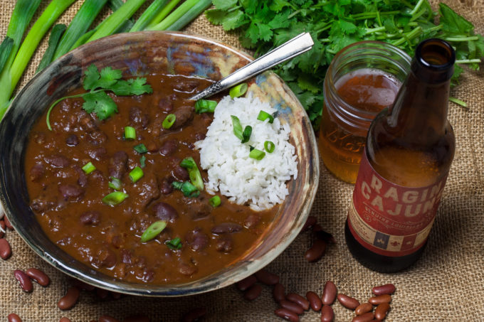 Hearty red bean chili stewed down in Ragin' Cajun beer is served up ...