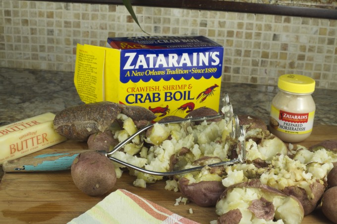 A double dose of crab boil seasoning and horseradish elevate these potatoes to the heights of a Cajun recipe for Alligator Sausage and Creole Red Onions.