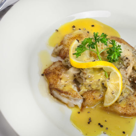 Flounder Topped with Crabmeat Dressing and a Saffron Velouté
