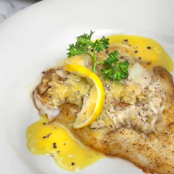 Flounder topped with crabmeat dressing is a popular for Crab topping for fish
