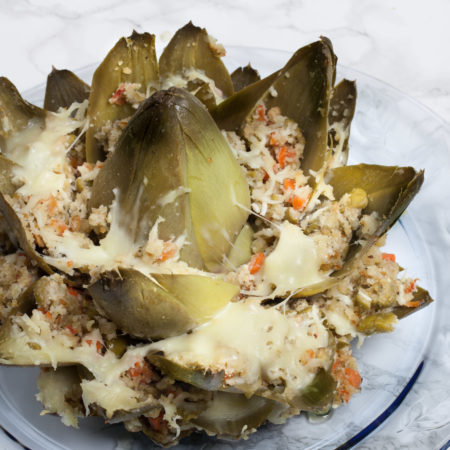Oven-baked and dripping with olive oil , this simple stuffed artichoke explodes with flavor.  (All photos credit: George Graham)