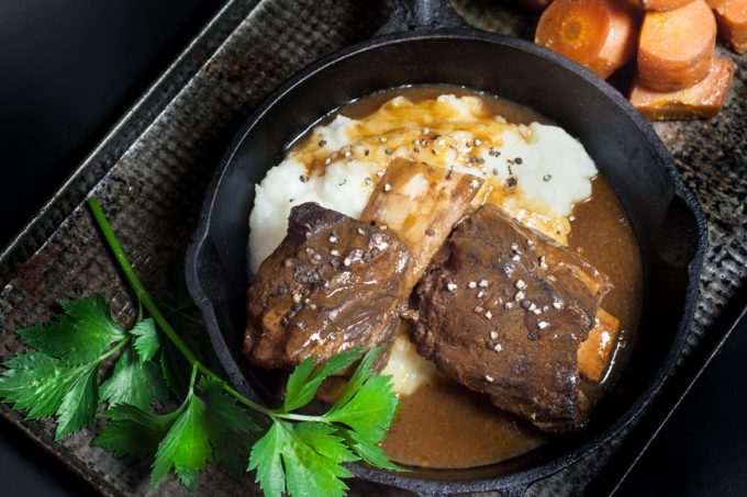 The rich, earthy flavors of beef ribs bathed in a dark coffee-infused gravy.