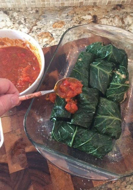 The tomato-based gravy adds a depth of flavor that works deliciously with these Stuffed Collard Rolls.