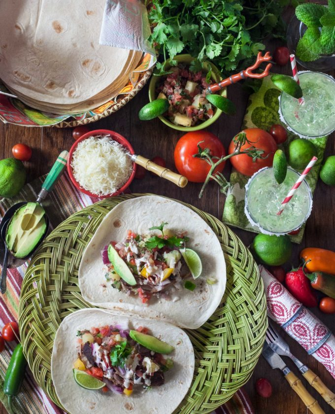 Don't forget the margaritas--the perfect accompaniment for these Pulled Pork Tacos.