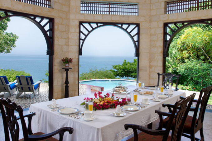 Overlooking the Caribbean, the dining room view is dramatic. (Photo credit: Internet archive)