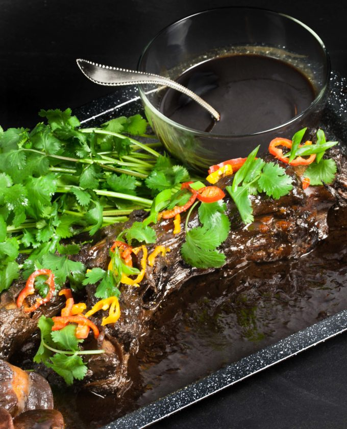 Whole Braised Oxtail with Pepper Jelly Glaze is sweet and spicy.