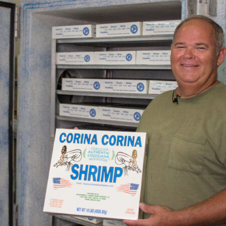Shrimper Bryan Mobley with a 10 lb. box of his plate-frozen shrimp. (Photo credit: George Graham)