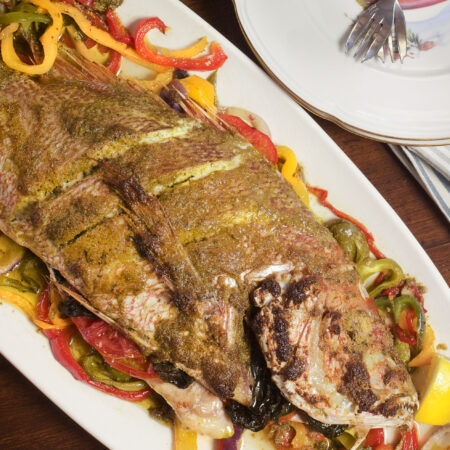Whole Red Snapper stuffed with flavor is a dramatic plate presentation. (Photo credit: George Graham)